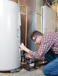 a technician performs a water heater service in cherry hill nj