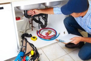a plumber in mapleshade township fixes a drain