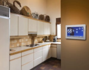 a smart thermostat in cherry hill sits on a wall