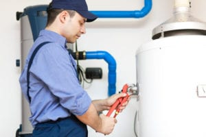 a plumber works on a boiler installation in cherry hill