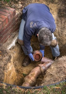 a man repairs a sewer line in cherry hill
