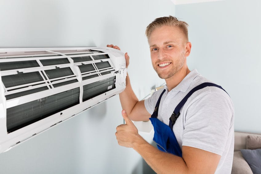 technician replacing air conditioner in cherry hill nj