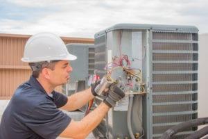 Tech working on air conditioning repair in Burlington, NJ